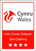 Visit Wales logo 4 star grade self catering holiday accomodation