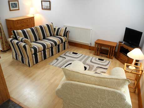 Lounge area showing settee and chair
